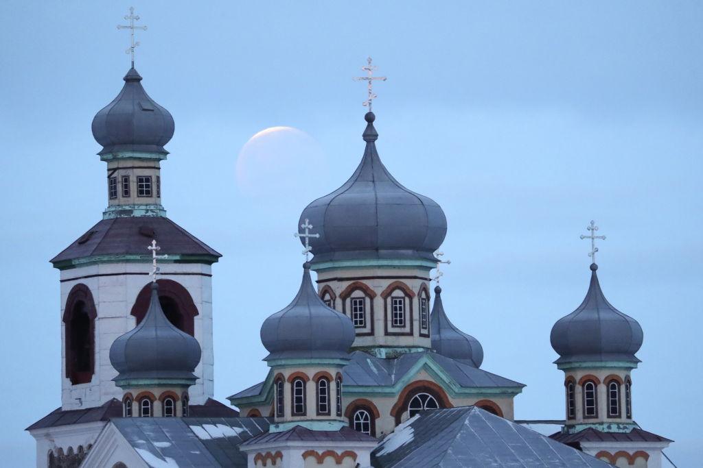 A lunar eclipse is captured over a church in Belarus