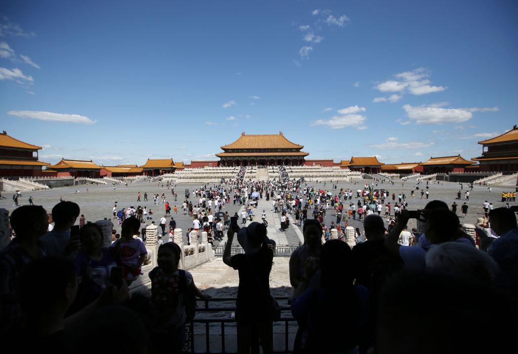 Crowds of people visit the Forbidden City in Beijing
