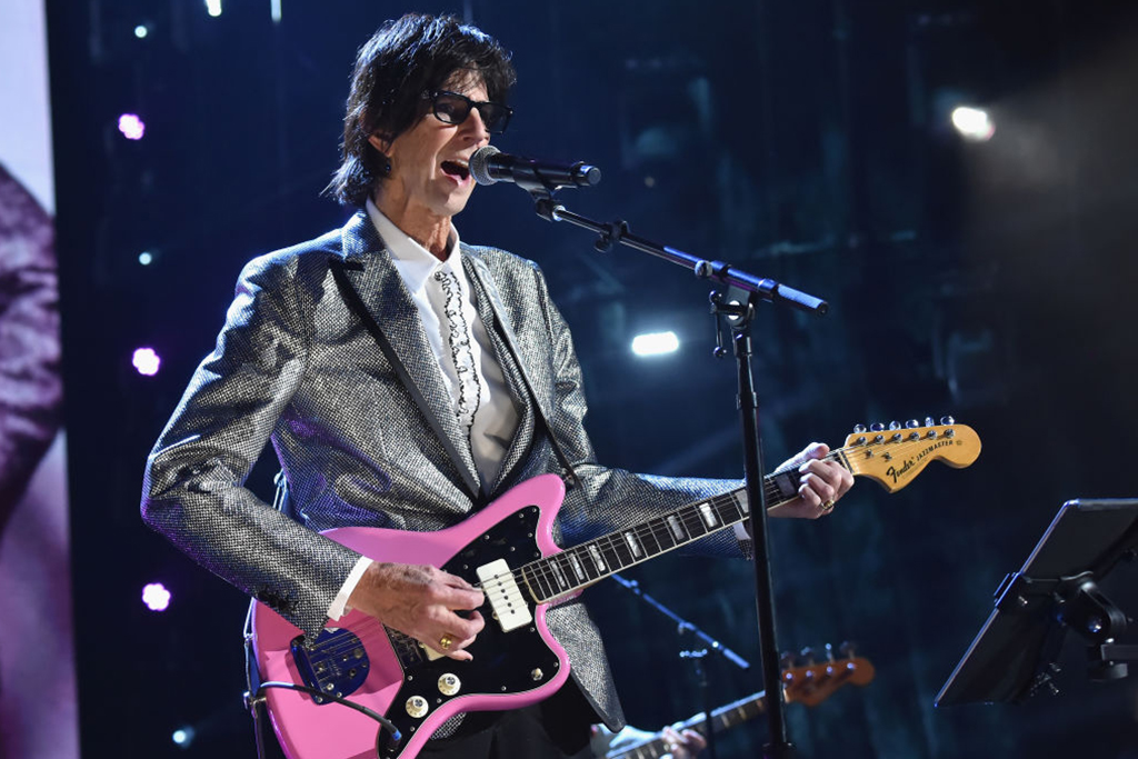 Ocasek playing guitar