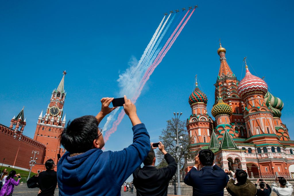Russian aircrafts fly over Red Square releasing colors of the Russian flag