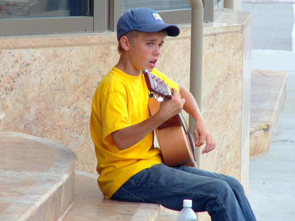 younger with guitar