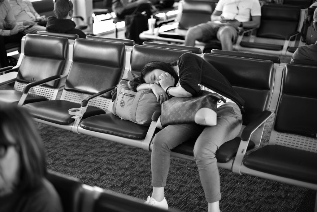 A Woman Sleeps In An Airport
