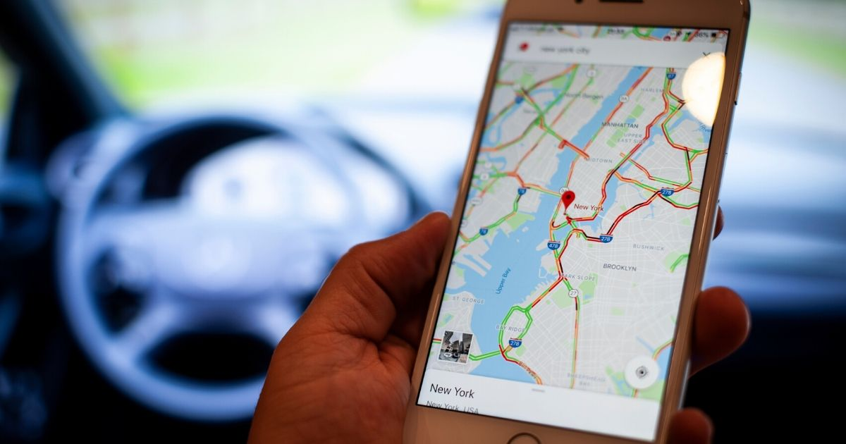 A mobile phone with the Google Maps application is seen in this photo illustration