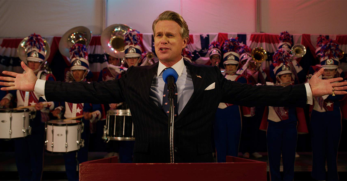 cary elwes standing in front of a marching band