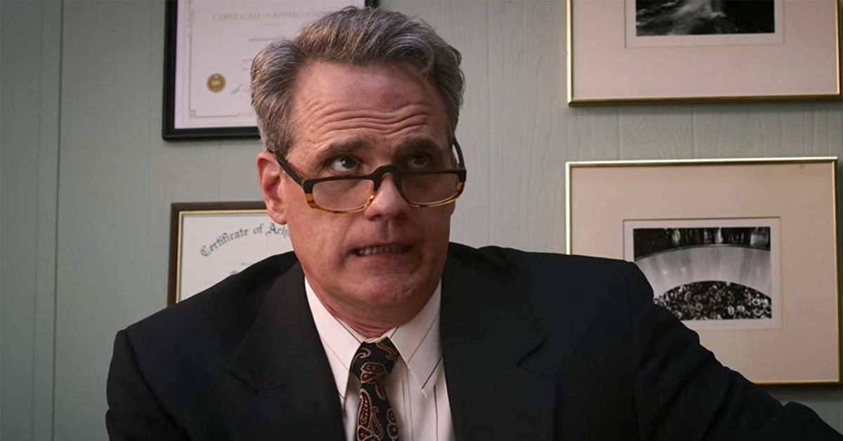 michael park wearing a suit in an office