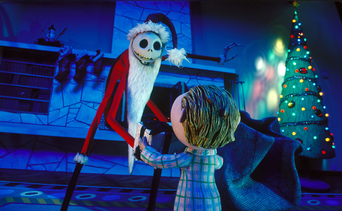 Santa Jack Hands A Present To A Small Child