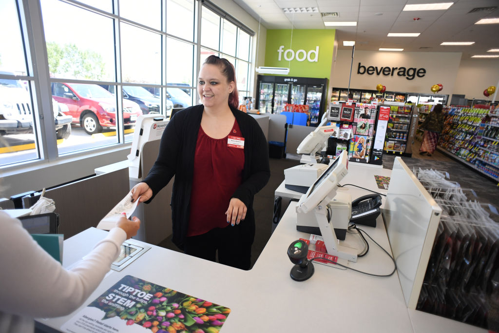 Melissa Bendever, of CVS Pharmacy, helps a shoppers