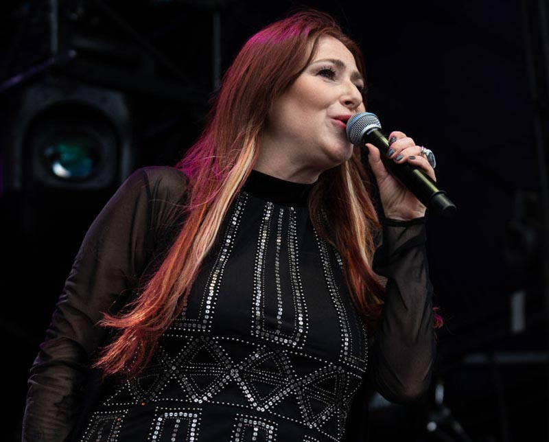 Tiffany performs onstage in England in 2019.