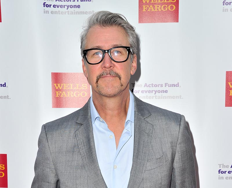 Alan Ruck now has gray hair and a long mustache.