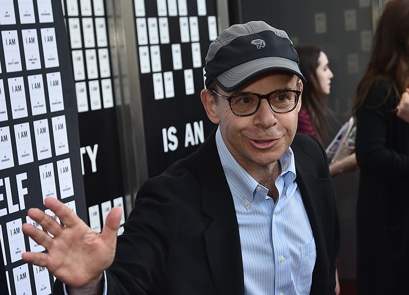 Rick Moranis is photographed mid-sentence looking like his usual, goofy self.