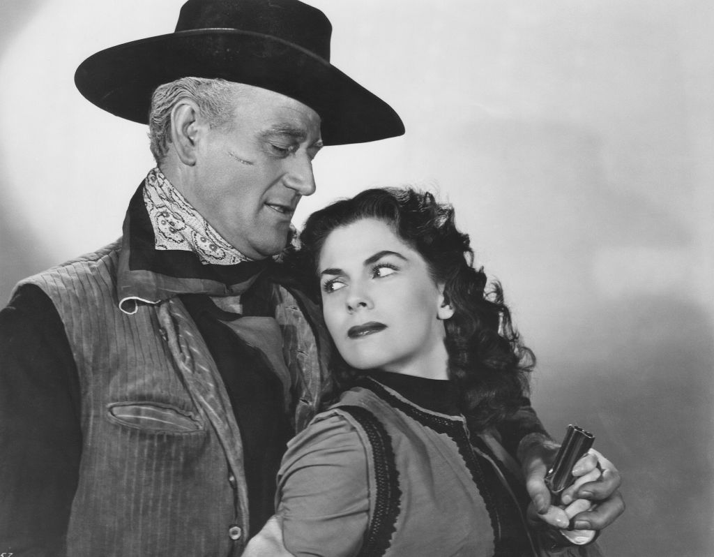 John Wayne and Joanne Dru on the set of