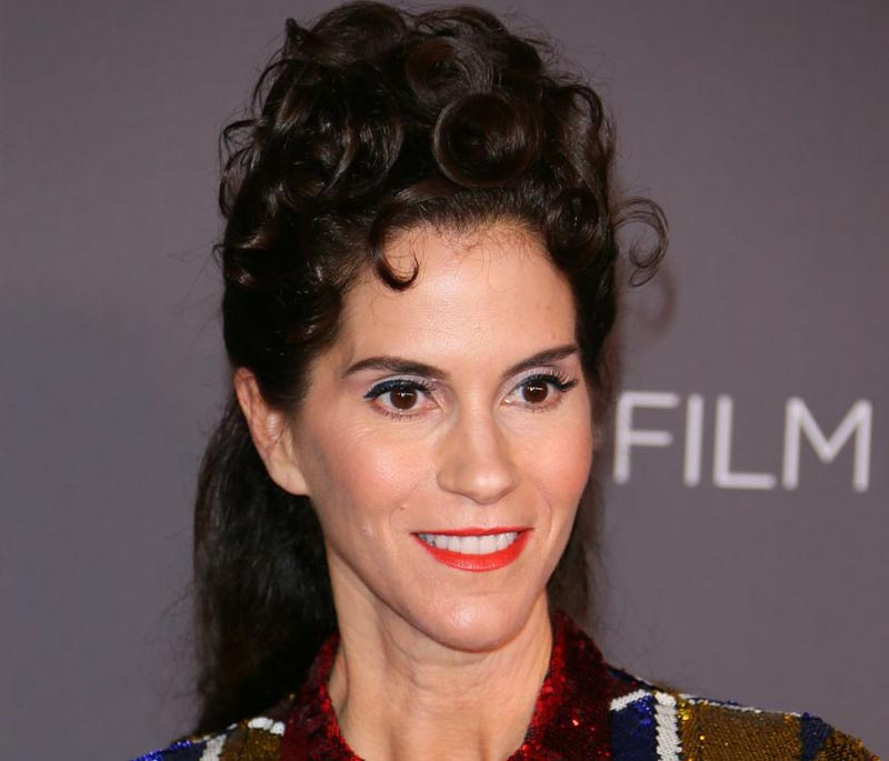 Jami Gertz wears her hair in an intricate updo at a Film Gala