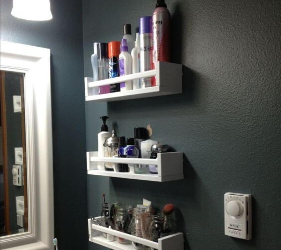 using spice racks for bathroom storage