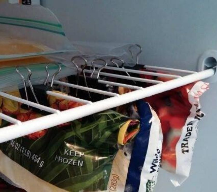 using binder clips to organize the freezer