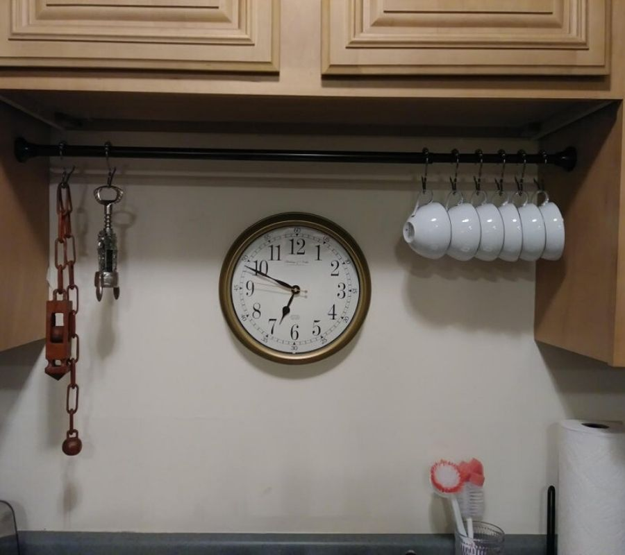 using tension rod for kitchen storage