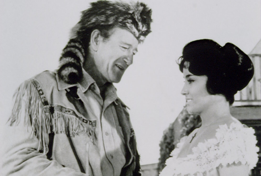 Argentine-American actress Linda Cristal with American actor and director John Wayne on the set of his movie The Alamo