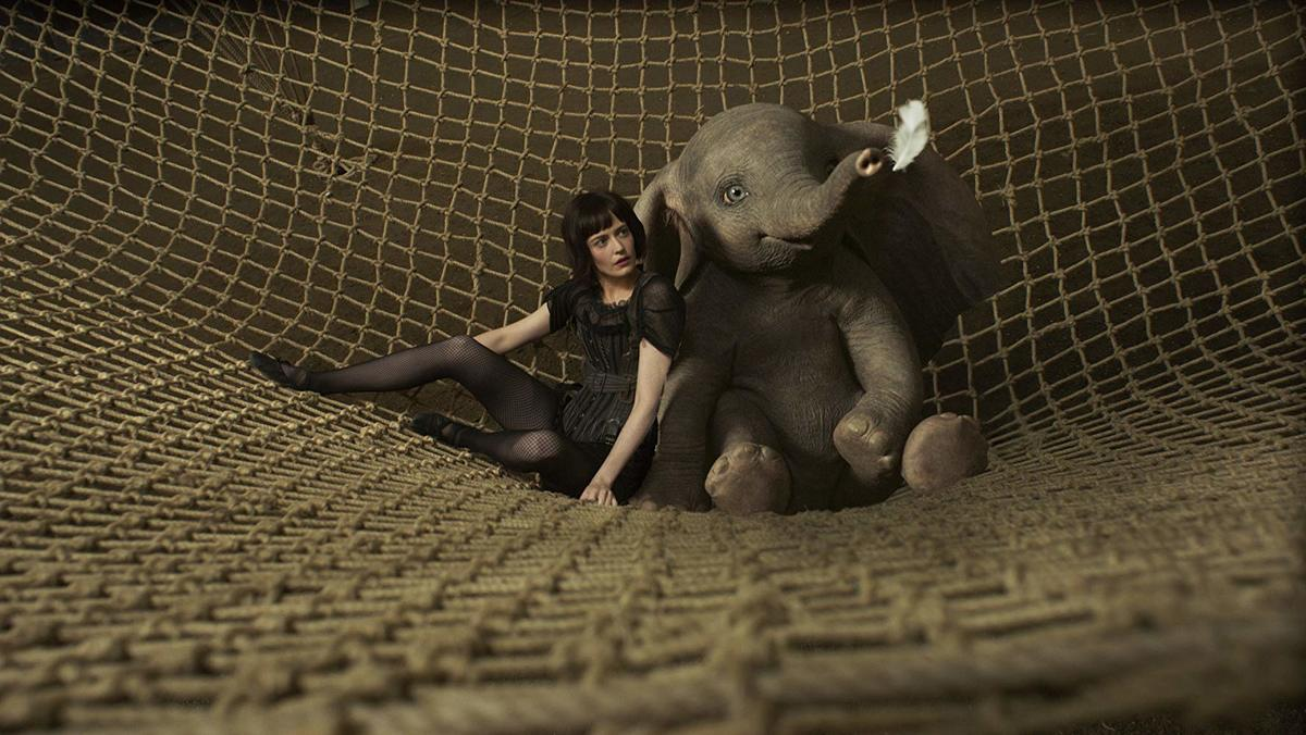 eva green sitting in a net with a cgi dumbo