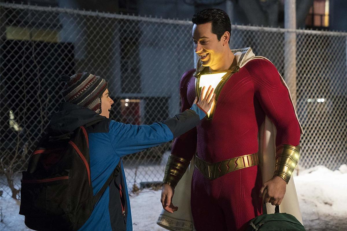 jack dylan grazer touching zachary levi's light-up superhero suit in shazam!