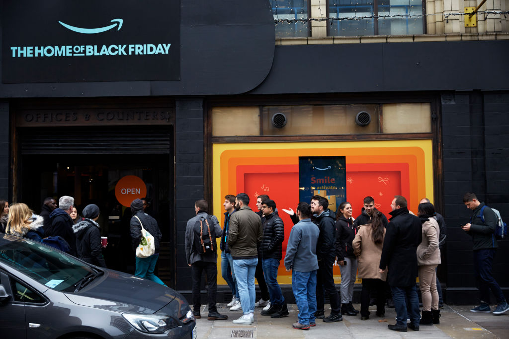 Shoppers queue outside an Amazon Black Friday pop-up