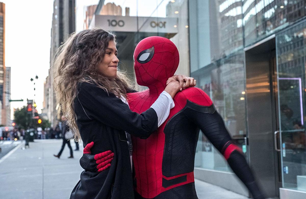 zendaya hugging spider-man on a sidewalk