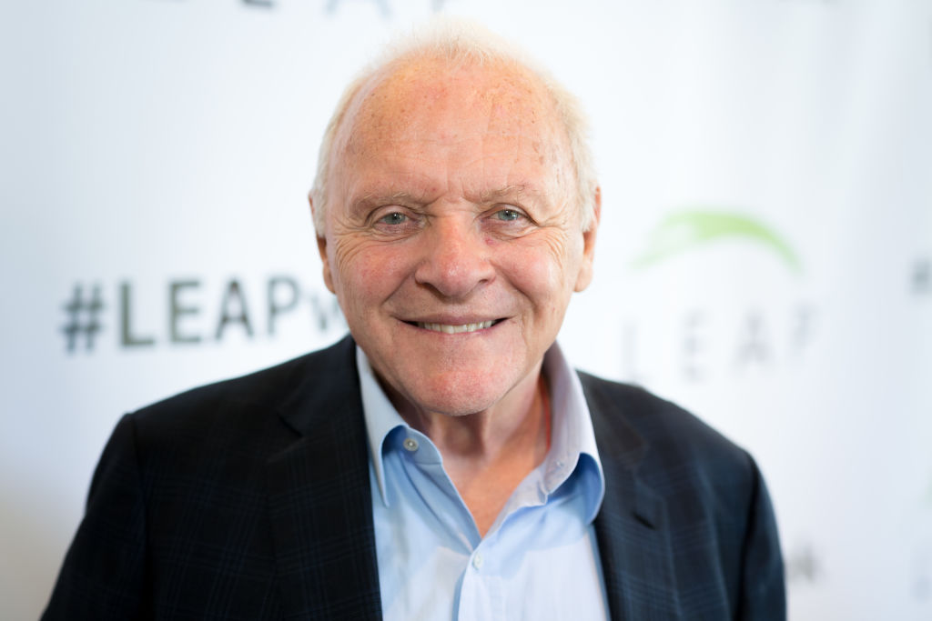 An aged Anthony Hopkins smiles at an event.