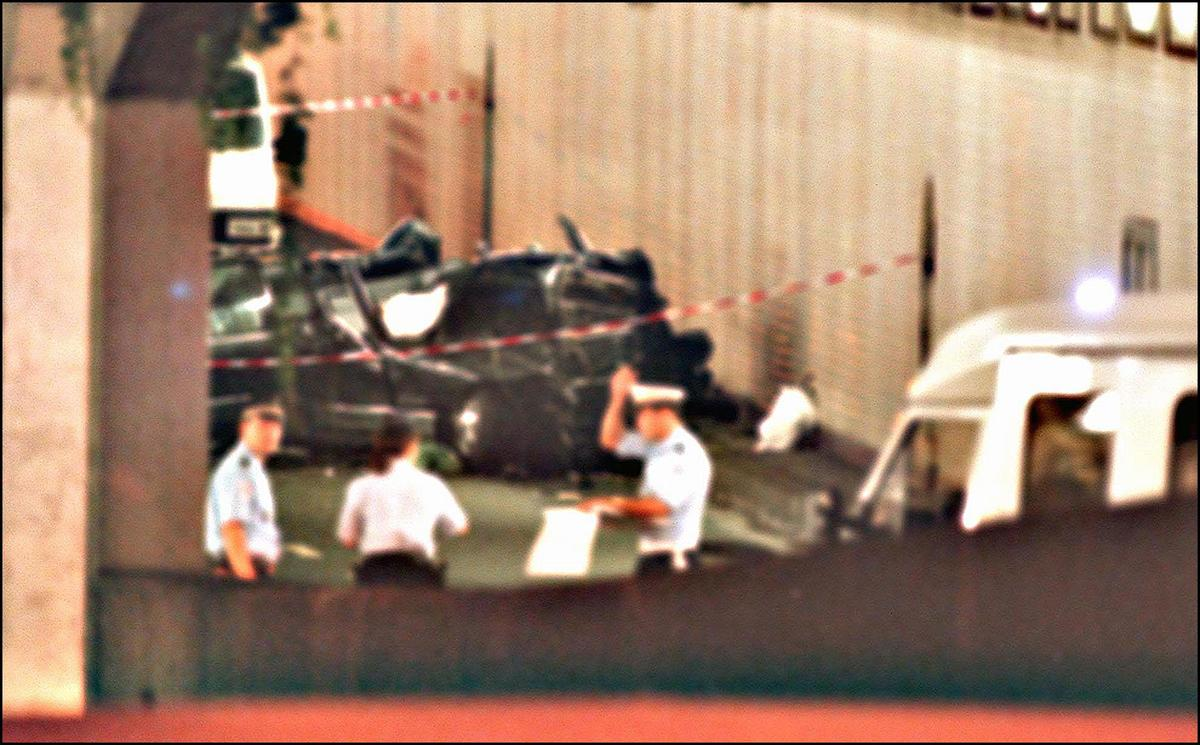 Police mark off the wreckage of Princess Diana's car.