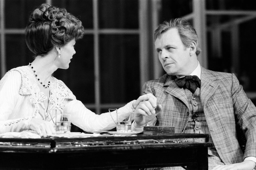 Anthony Hopkins performs with an actress onstage.