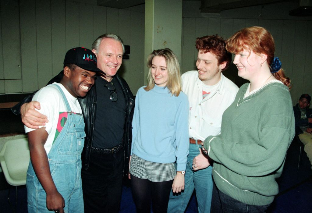 Anthony Hopkins hugs an acting student.
