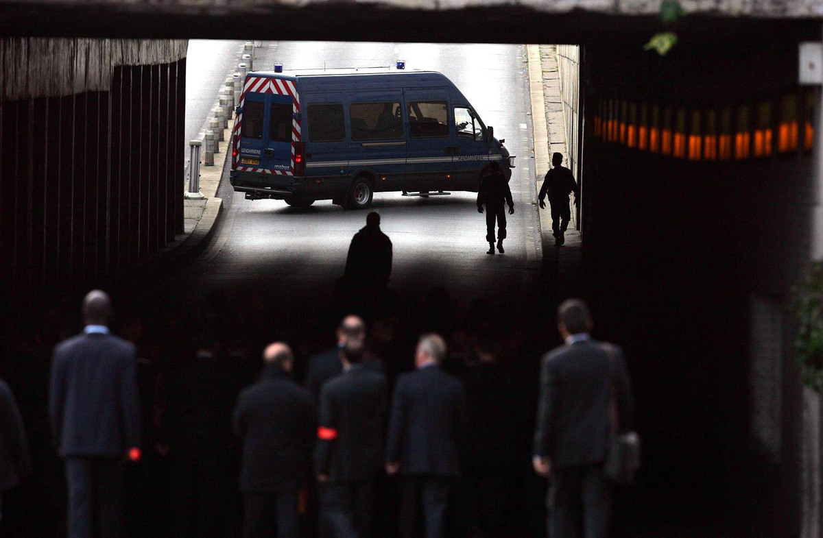The jury from the Coroner's inquest into the deaths of Diana, Princess of Wales and Dodi Al Fayed enter the Pont de l'Alma tunnel in Paris where the Mercedes the couple were travelling in crashed.