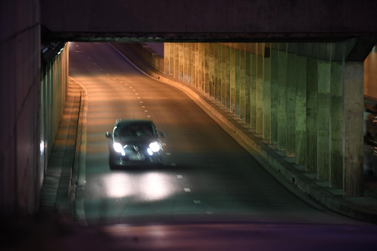 A car is seen driving through the Alma tunnel bridge, where Princess Diana's car crashed.