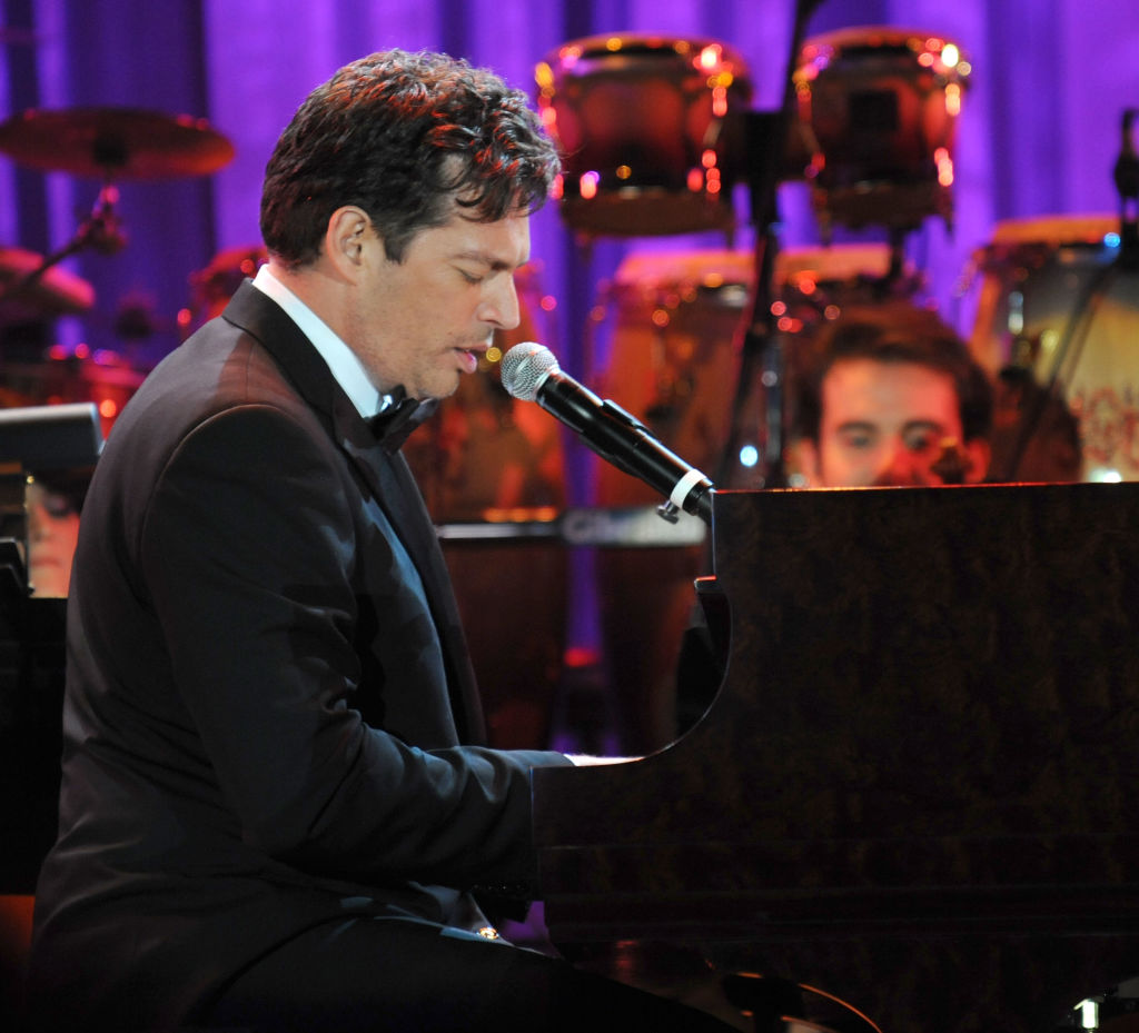 Harry Connick Jr. sings and play piano onstage.