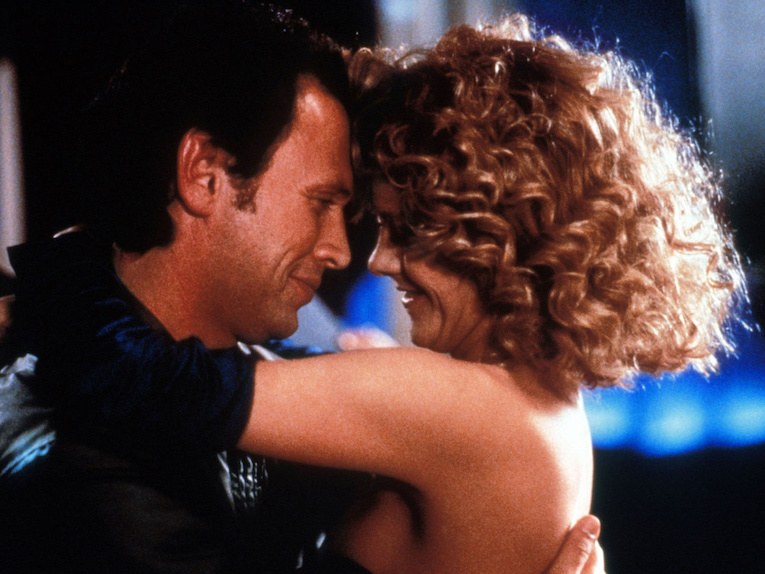 Harry and Sally smile and embrace.