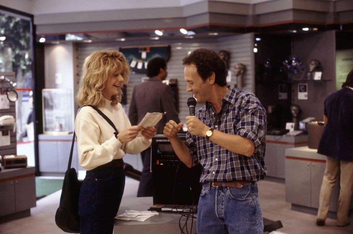 Harry and Sally joke around with a karaoke machine.