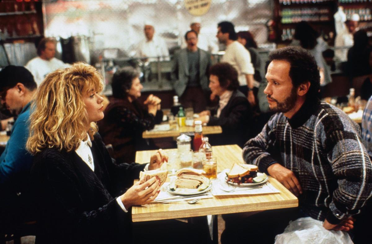 Harry and Sally sit in a restaurant.