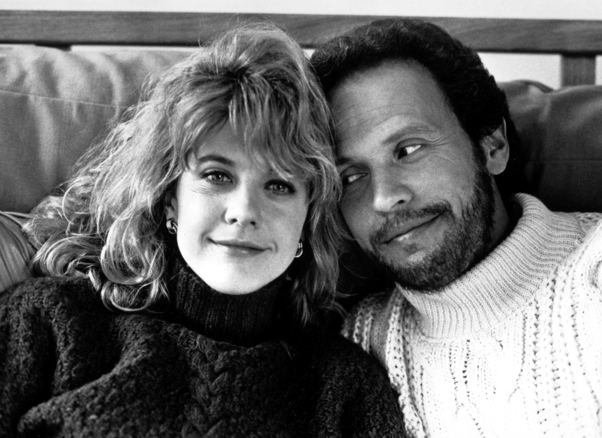 Billy Crystal smiles at Meg Ryan for a promo photo.