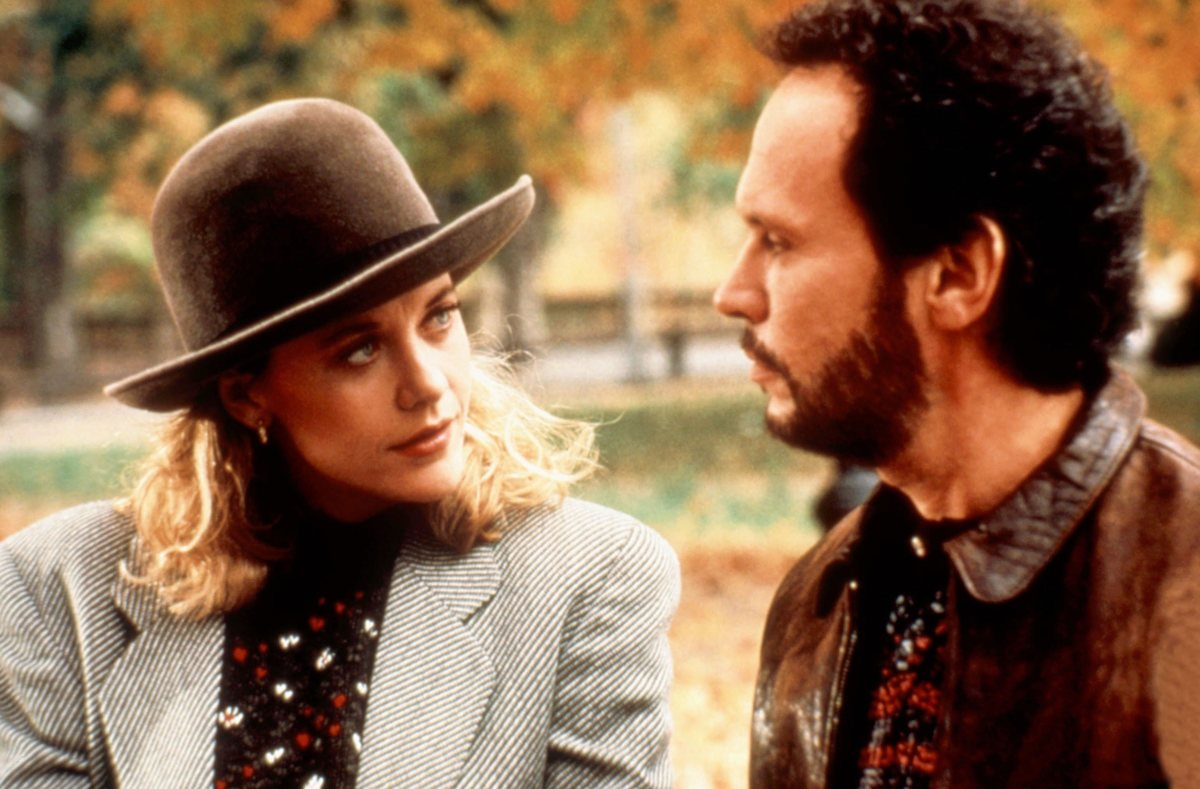 Harry and Sally talk in the park.