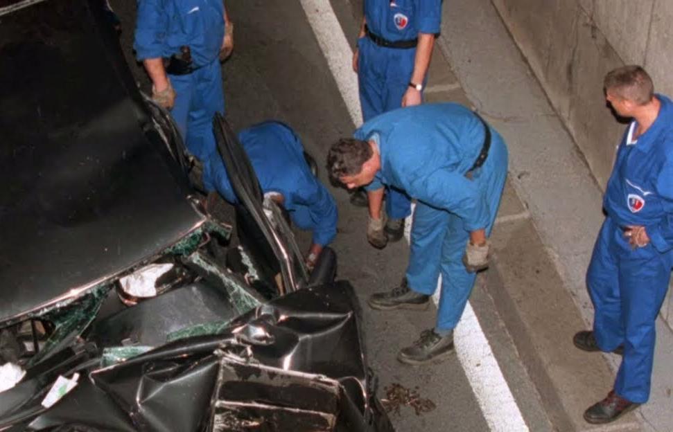 A rescue team attends the crash site of Princess Diana.