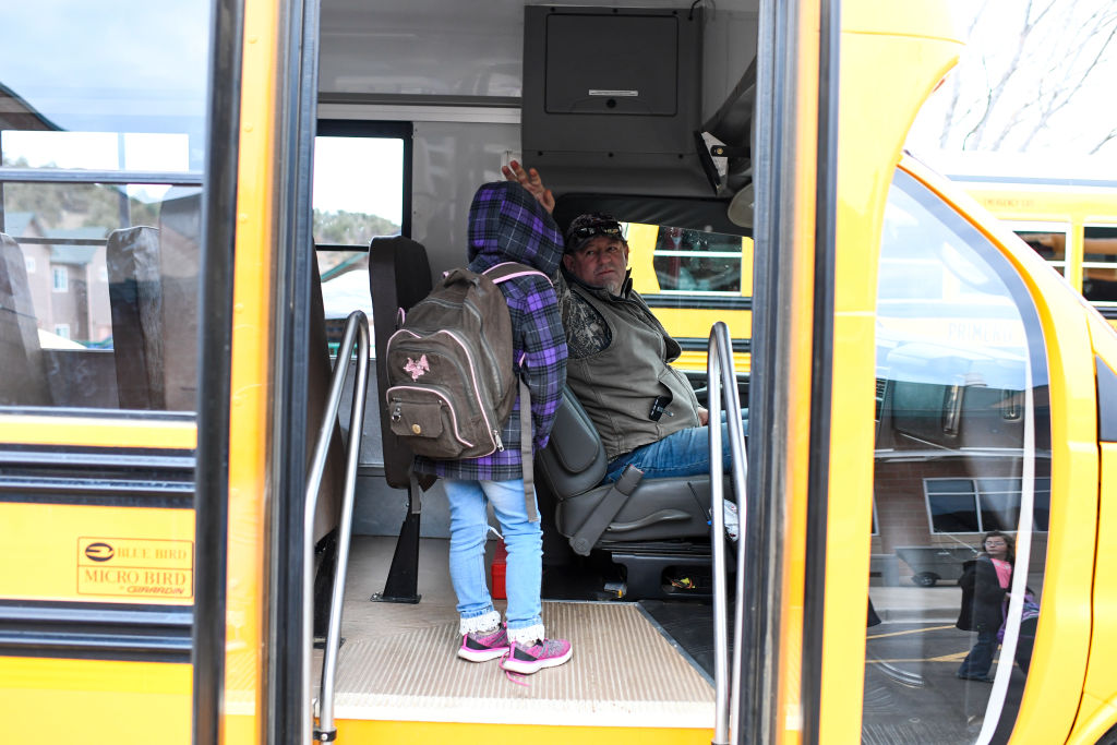 school bus driver with a student