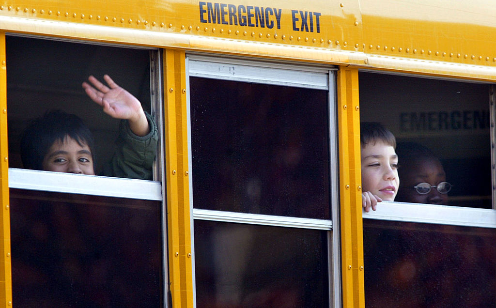 kids waving from the school bus