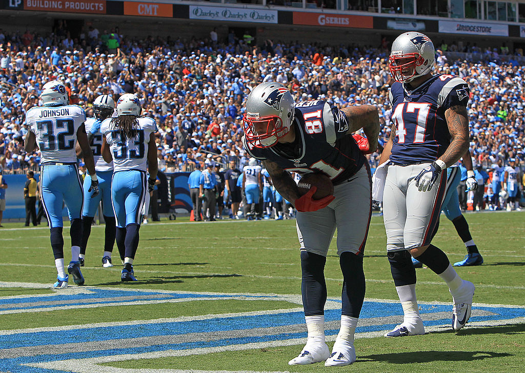 aaron hernandez bows after scoring a touchdown