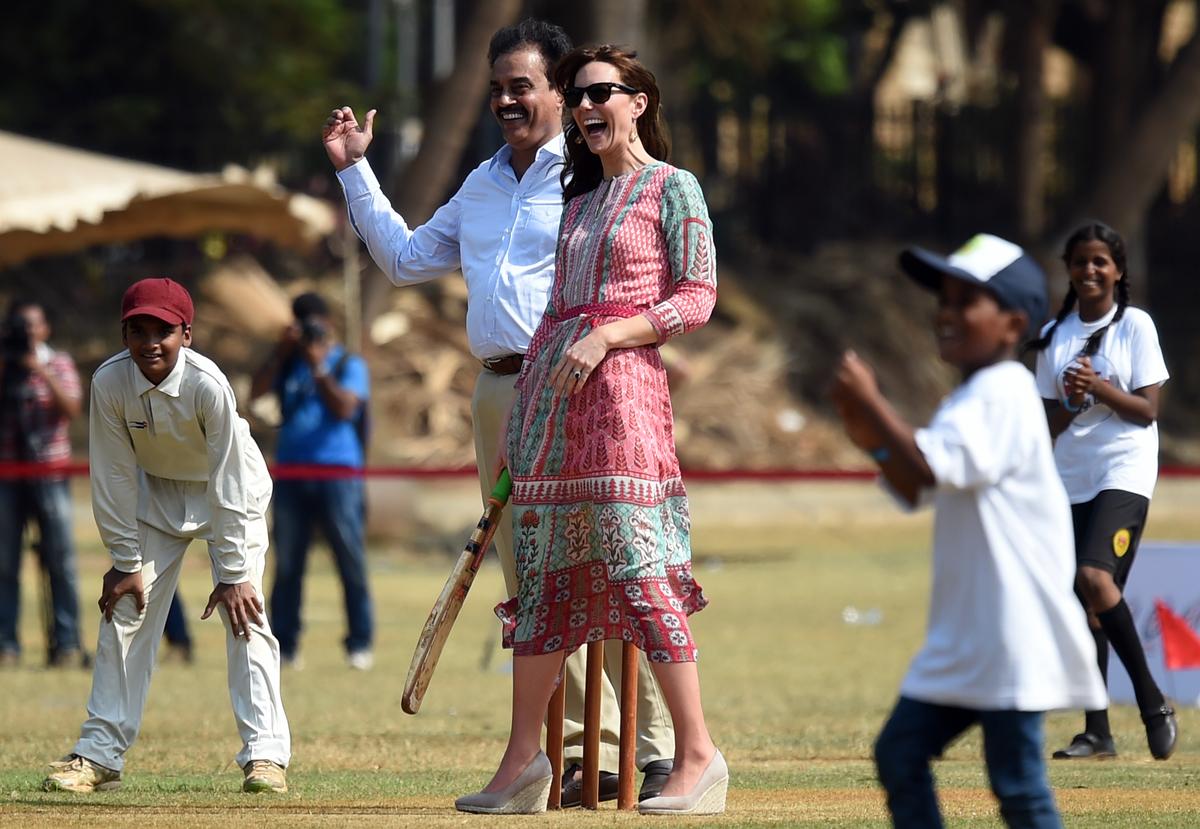 Kate Middleton plays cricket with former champion Dilip Vengsarkar.