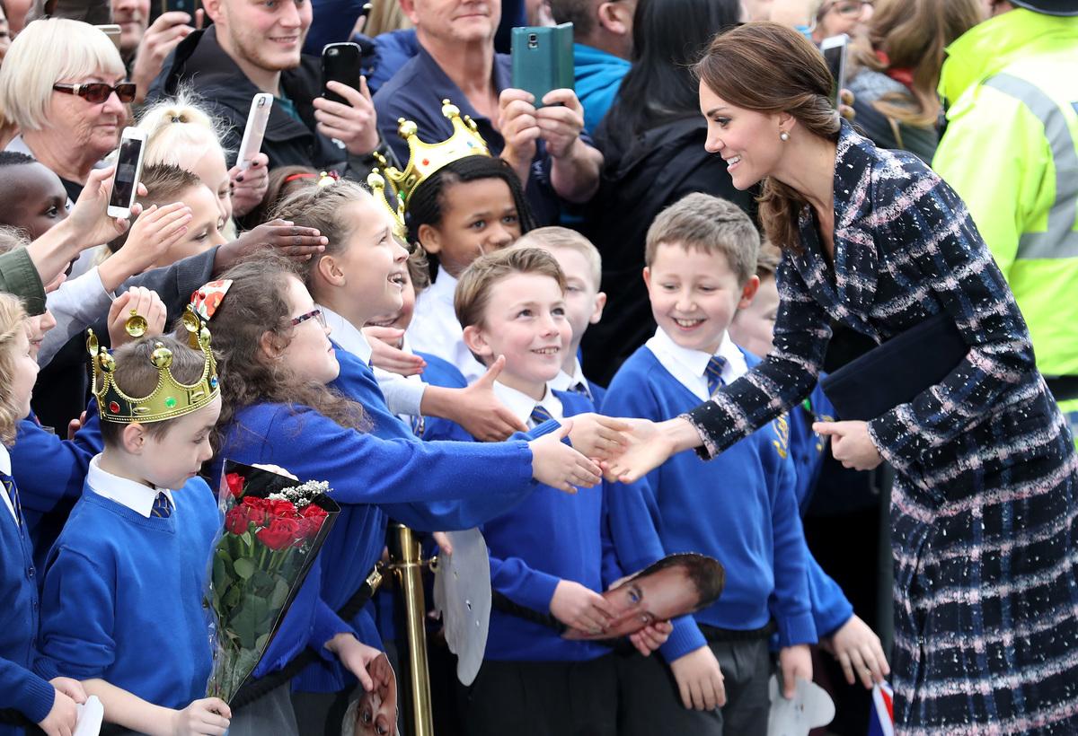 Catherine, Duchess of Cambridge meets children from St Philips school.