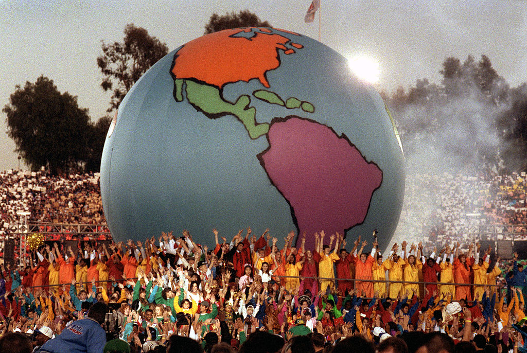 A giant model of the world rests amongst Heal the World performers during the 1993 Super Bowl.