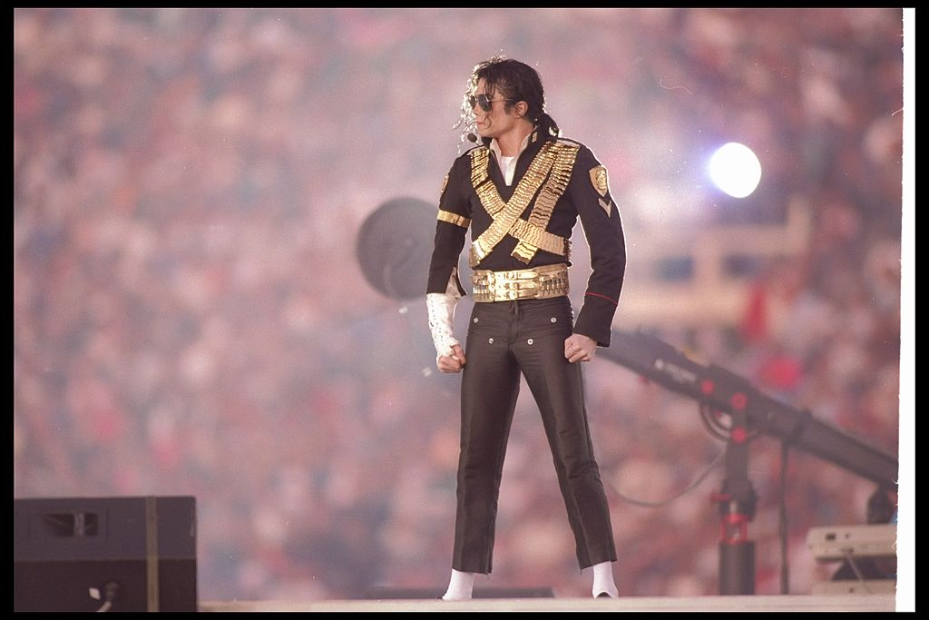 Michael Jackson poses onstage during the 1993 Super Bowl.