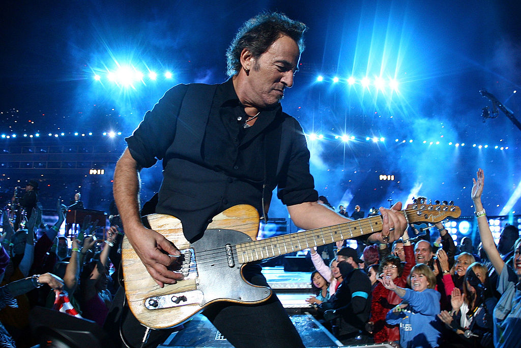 Bruce Springsteen plays his guitar at the Super Bowl.