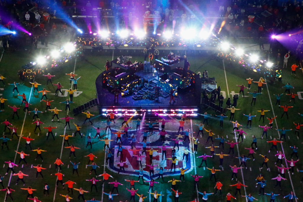 Performers fill the field during the Super Bowl.