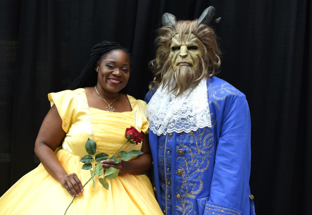 a couple dressed as belle and the beast from beauty and the beast