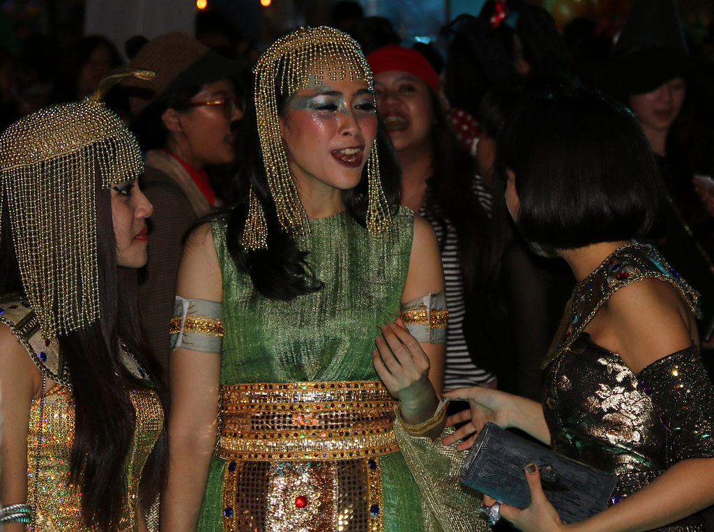 a couple women dressed as cleopatra