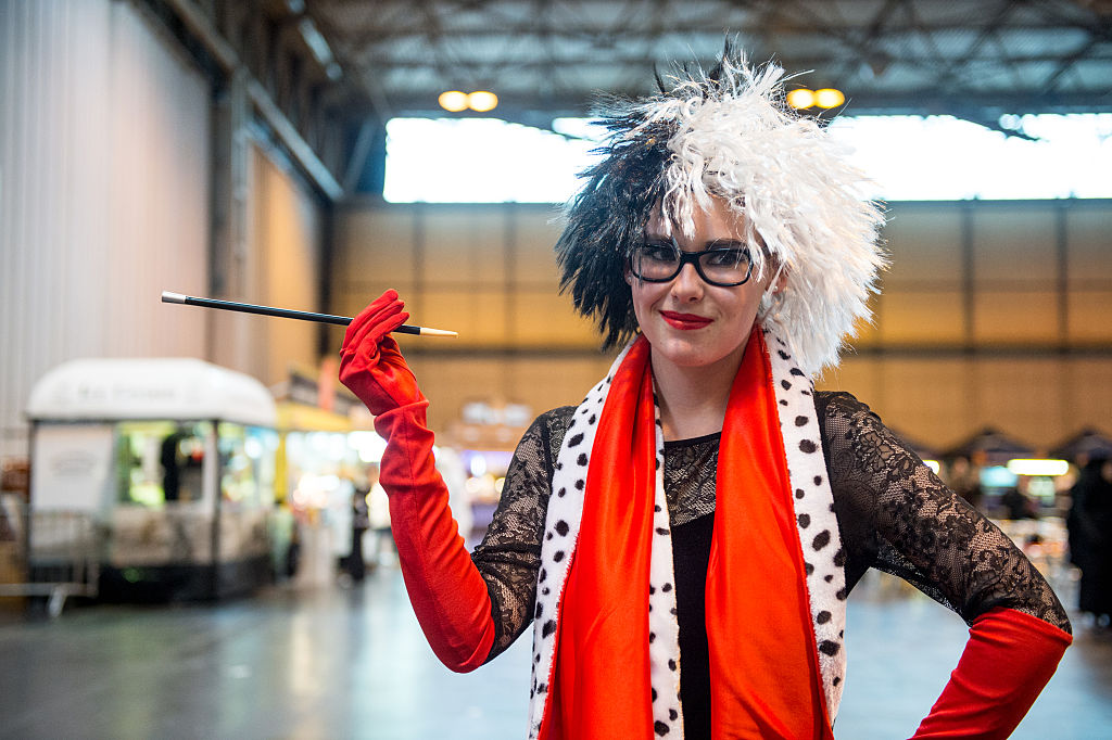 a woman dressed as cruella de vil from 101 dalmations