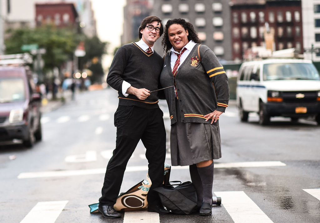 a couple dressed as harry potter and hermoine granger
